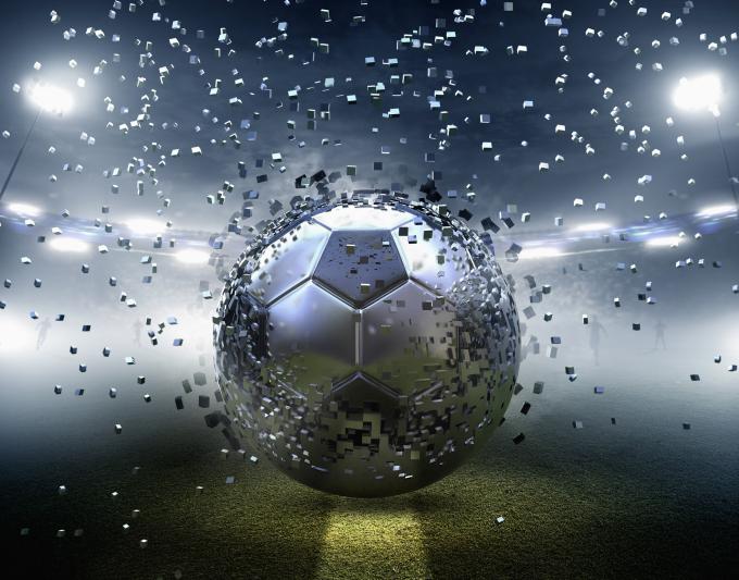 Futuristic silver soccer ball exploding into pixels